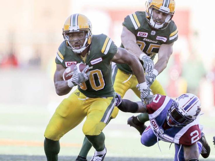 WK 16 - Edm.40 - Mtl.20 - #30 John White of the Edmonton Eskimos breaks a tackle by Montreal Alouettes' #2 Jovon Johnson during CFL action at Molson Stadium in Montreal on Monday, Oct. 10, 2016.