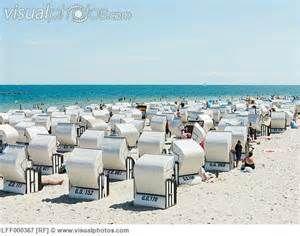 Germany,Ruegen, Binz, People in beach booth at Island of Rugen