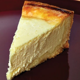 "Eggnog Cheesecake: 16 oz cream cheese, softened, ½ cup sugar, 2 tbsp flour, ¼ tsp salt, ½ tsp nutmeg, 2 tbsp dark rum or 2 tsp vanilla, 3/4 cup Silk Nog, 2 eggs, Using an electric mixer beat cream cheese, sugar, flour, salt an& nutmeg until light an& fluffy, scraping sides of bowl. Beat in rum or vanilla & Nog,Beat in eggs, one at a time. Pour in 9"" bake deep-dish graham cracker crust, bake @ 359 25-30 min til set. Chill. gm"