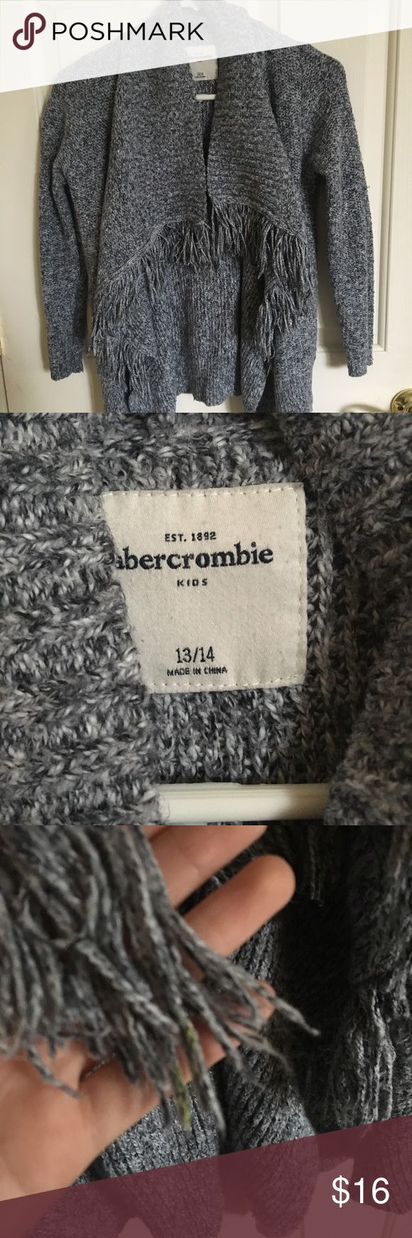 Abercrombie grey cardigan sweater Grey cardigan from Abercrombie, gently worn and in good condition except for few strands of fringe that yellow paint on them. Keeps you super warm and goes with a lot of outfits abercrombie kids Shirts & Tops Sweaters