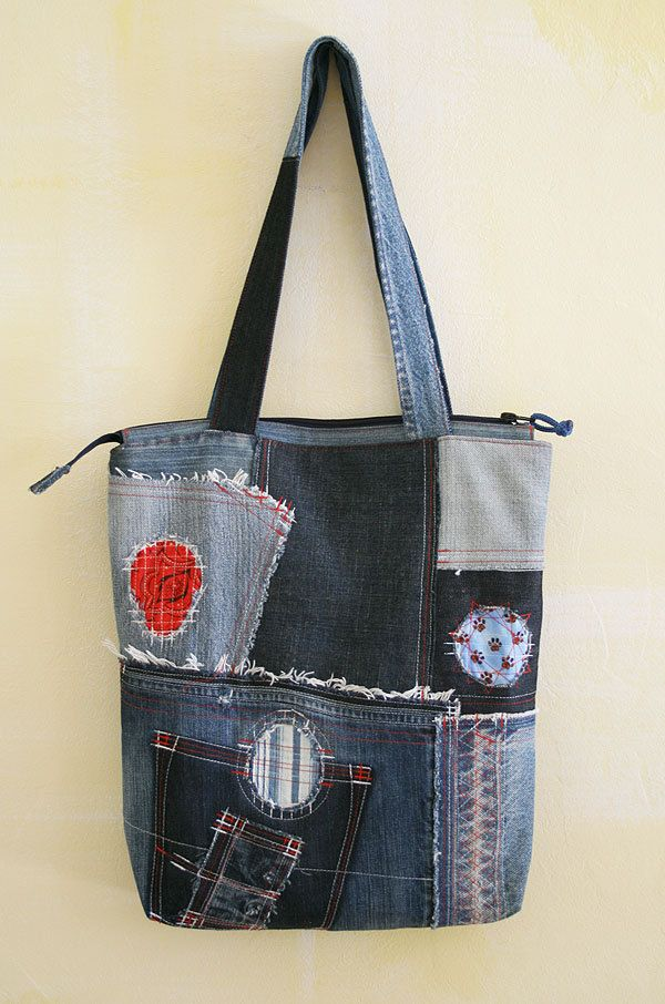 This denim tote bag is good for unusual people who like unusual things. Loose cozy minimalist clothes are enough with it to make a whole stylish casual look. The bags made of used jeans of different shades of blue colour. Bright circles give the bag playful look. The bag features 2 pockets for a cell phone or a packet of tissues and a zip pocket inside, a zip closure. The lining is dark grey natural fabric. The length of straps 60 cm Height approx 40 cm Length approx 35 cm Depth approx 6…