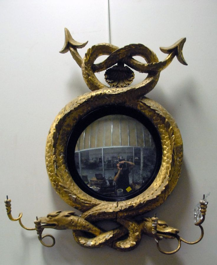 Federal girandole mirror having two serpent surround, each head with dual candle holder (regilt finish).  ht. 38 in.  Provenance: Property from The Estate of Margaret Oliphant of Old Lyme, Connecticut - Realized Price: $10,530.00