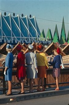 View of a group of five women in colorful outfits as they look over the 1967 Universal and International Exhibition, also known as Expo '67 or the Montreal World's Fair, Montreal, Canada, 1967.