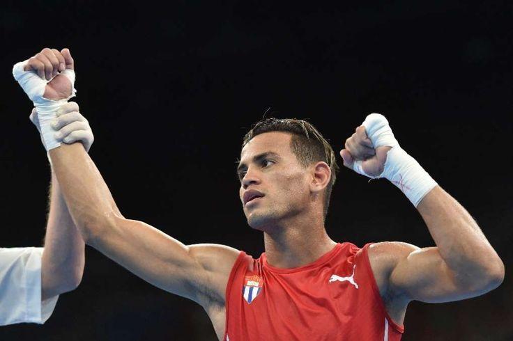 Rio braces for US-Cuba Olympic boxing clash:  August 18, 2016  -     Cuba's Robeisy Ramirez celebrates winning against Uzbekistan's Murodjon Akhmadaliev during the men's bantam semifinal match on August 18, 2016
