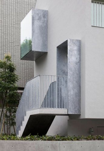 Galvanised projections of entrance and bay window Meguro city, Tokyo, Japan House in Yakumo YAITA AND ASSOCIATES