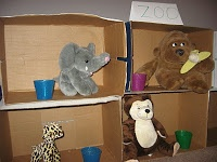 """Preschoolers can learn about being a zookeeper by creating a zoo of their own using cardboard boxes and stuffed animals. Encourage the children to regularly """"feed"""" the animals and pretend to give them water. If you have a doctor kit, it's also fun to care for any sick animals."""