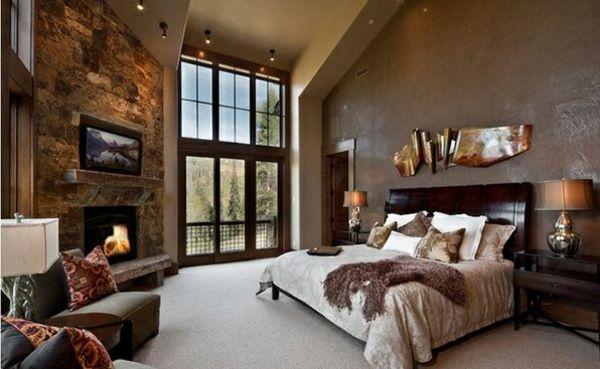schlafzimmer ideen traditioneller stil steinwand kamin wandfarbe braun