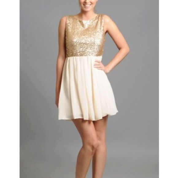 Asos mad men champagne sequence dress wedding Love this dress!! Very reminiscent of the 1960's Mad Men era. Beautiful champagne sequence bodice and soft breezy cream skirt. Great for summer weddings. Only worn twice. In perfect condition. TFNC London Dresses Mini