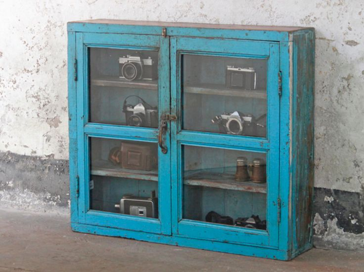 This is a great-looking vintage blue teak hardwood display cabinet with double glass doors. #vintagefurniture #furniture #woodenfurniture #cabinet #homedecor
