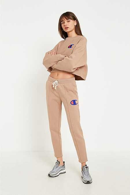 Champion - Pantalon de jogging fuselé marron clair. Champion - Pantalon de  jogging fuselé marron clair Pull Champion Femme e1ef6ebbaba