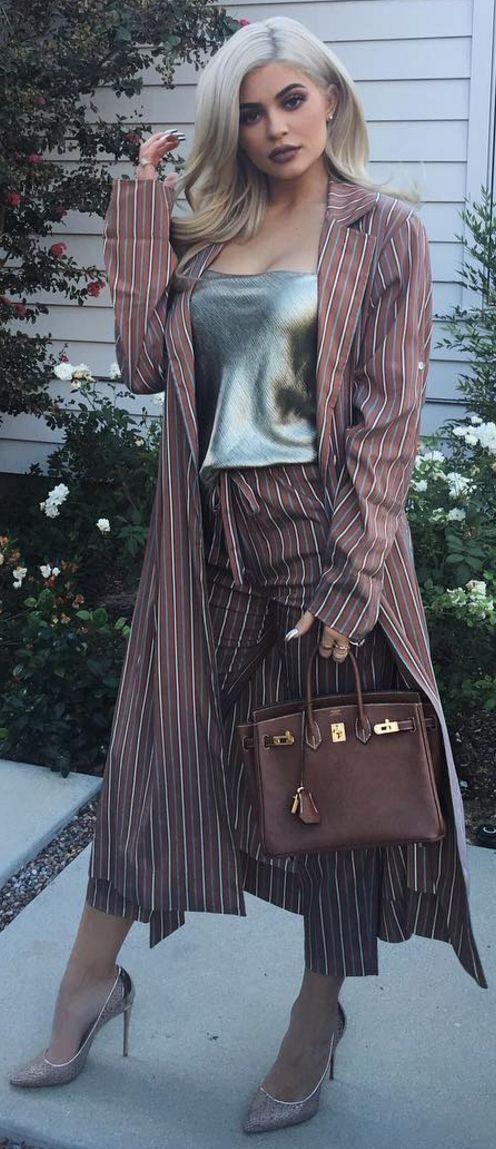 Kylie Jenner:Jacket and pants – Raquel Allegra  Purse – Hermes