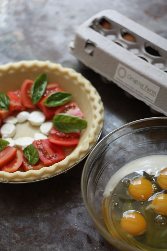 Origins Farm: Mozzarella Caprese Quiche. I may switch up the ingredients and the crust, but I love how the layering of whole ingredients looks after cooking. Beautiful!