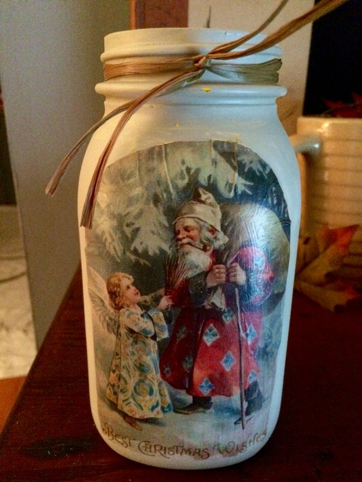 Printed out a copy of a vintage Christmas postcard. I used Mod Podge to attach it to the front of a quart size Kerr mason jar. Then I painted the jar with latex paint and added some raffia.