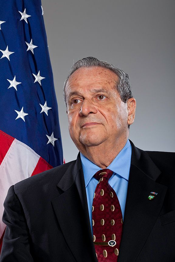 Felix Rodriguez - He served in the Army Special Forces; MACV-SOG; and the Special Activities Division of the CIA. He infiltrated Cuba weeks prior to the Bay of Pigs, and was able to escape capture. He completed over 300 missions in Vietnam in his effort to earn his U.S. citizenship. He was the CIA Operative who captured and interrogated the infamous butcher Che Guevara and still has his Rolex Watch.