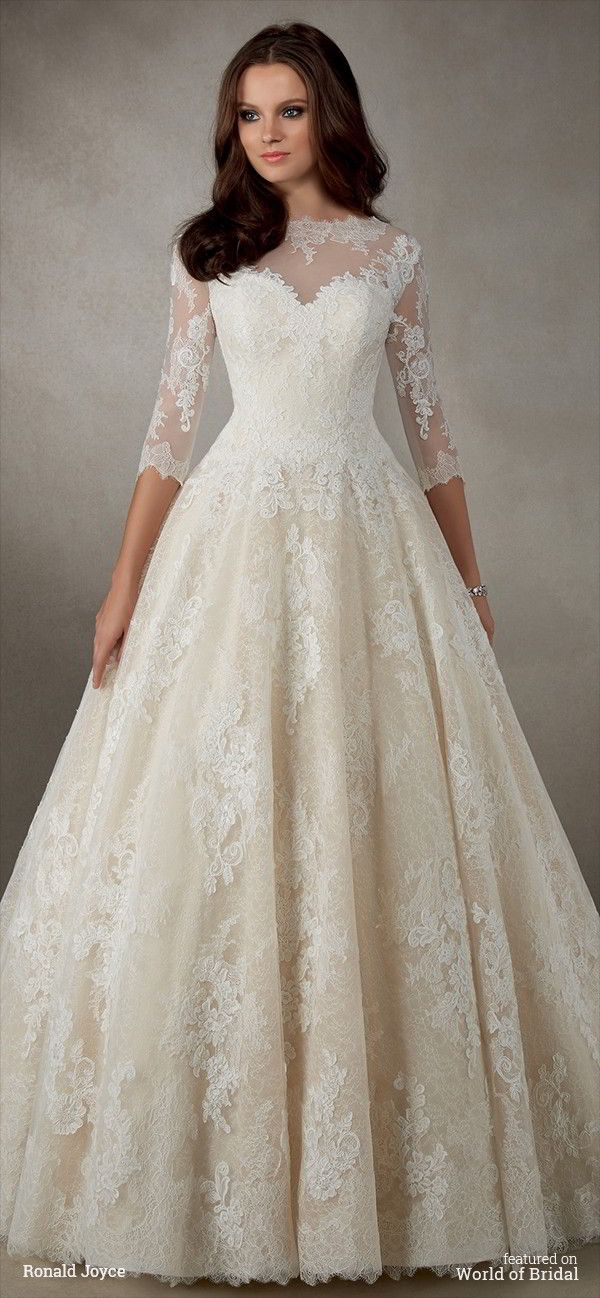 A classic lace A-line dress with ¾ length sleeves, illusion neckline and plunge back