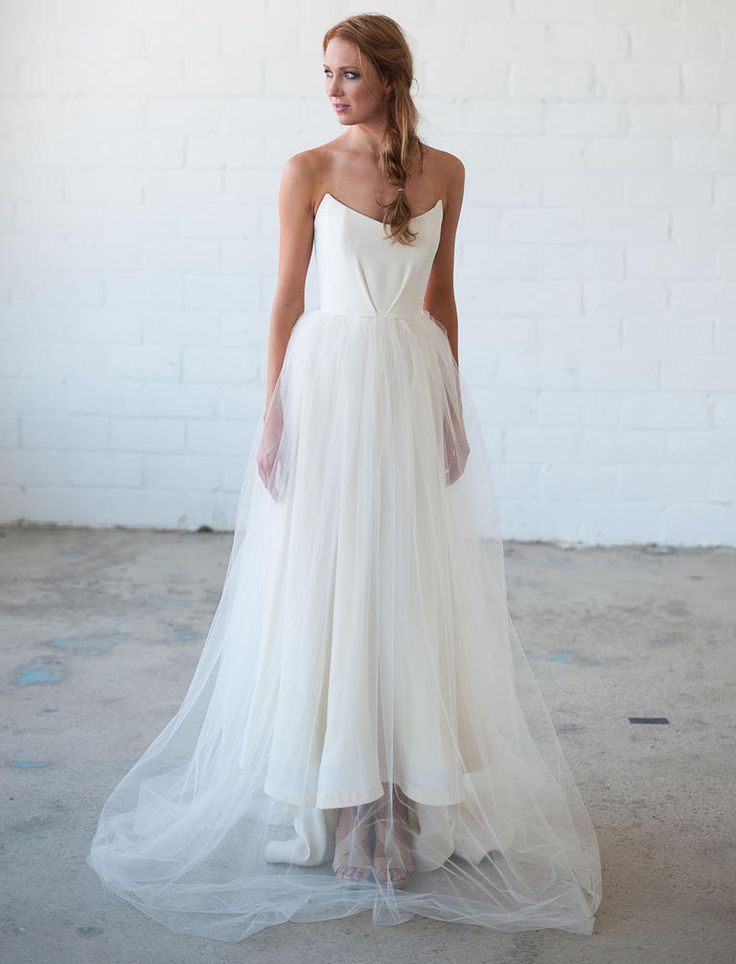 Tara LaTour Fall 2016 white strapless scoop neckline and tulle overlay wedding dress | https://www.theknot.com/content/tara-latour-wedding-dresses-bridal-fashion-week-fall-2016