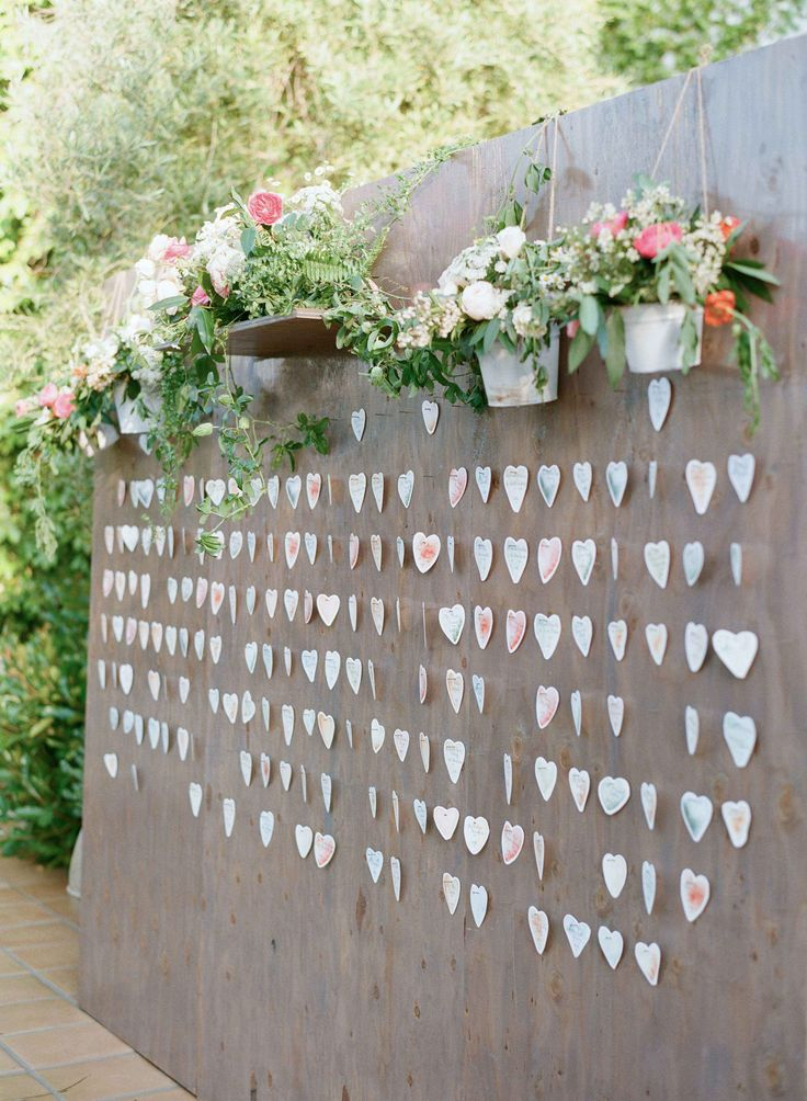 wedding table name card size%0A Freestanding wood wall with heart escort cards