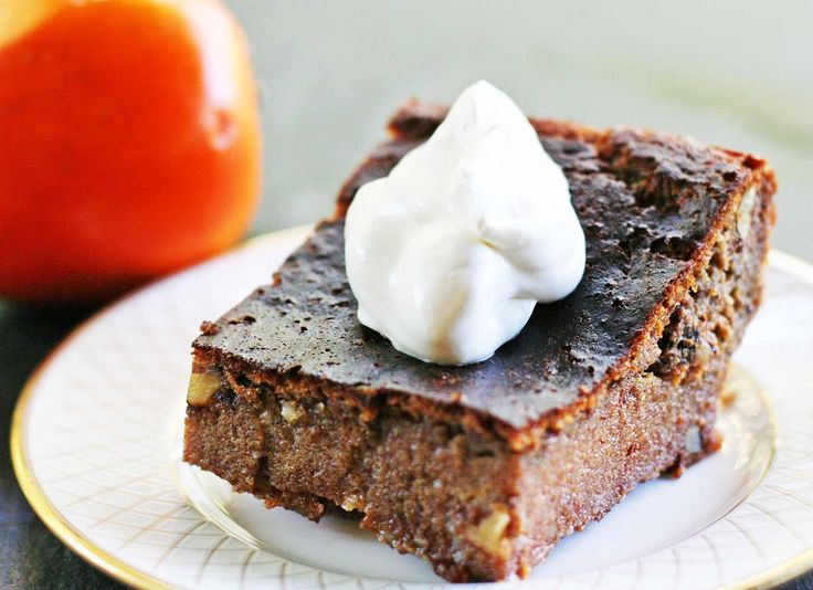Persimmon Pudding Cake ~ Rich and wonderful persimmon pudding cake, made with hachiya persimmon pulp, eggs, butter, milk, vanilla, flour, sugar, spices, and chopped nuts. ~ SimplyRecipes.com