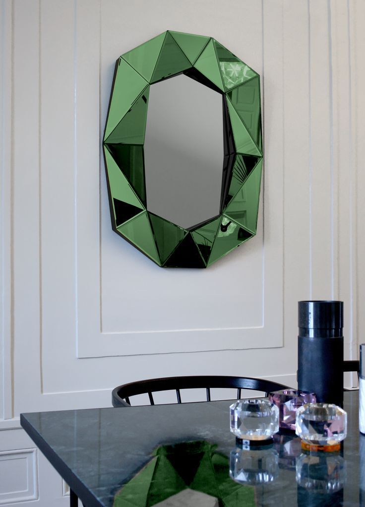 Diamond large emerald mirror get it at https://www.reflections-copenhagen.com/shop/mirrors/diamond-large/emerald-silver-black/