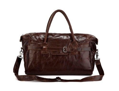 OKEANOS: Large Hand Luggage Cowboy Leather Bag  A classic vintage large hand luggage cowboy leather bag that will keep your style cool time after time.  This dispatch bag will impress with its functionality and quality. The perfect balance of classic exclusivity, while maintaining a cool attitude with signature leather craftsmanship.  Perfect for travelling with your gadgets like Laptops, iPads, eReaders, etc.  Ideal cabin size.  £99