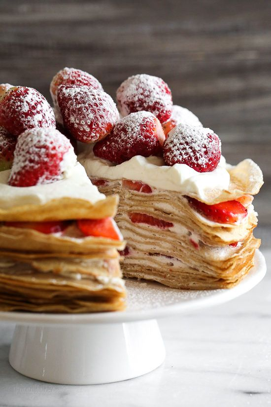 Crepes aren't just for rolling, something special happens with you layer then with cream and top them with strawberries. It creates a beautiful dessert, when you slice into it, you can see all the pretty layers.
