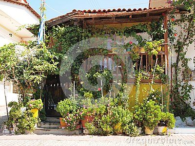 An old greek house with flowers