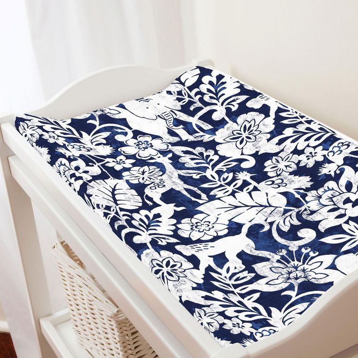 "Navy and White Jungle Changing Pad Cover by Carousel Designs.  Keep your baby comfortable and dry with this changing pad cover, designed to fit most contoured changing pads. Machine washable for easy clean-up. Fits standard contoured changing pads approximately 16"" x 32"".  #carouseldesigns"