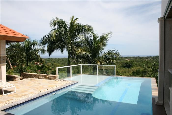 Luxurious oceanview villa for sale in Sosua Listing #: V-12156 LG City: Sosua Price: U$890,000 Bedrooms: 6 Bathrooms: 6 Apartments: 1 Living area (sq. Feet): 6727,44 / sq Meters: 625 Lot Size (sq Feet): 43077,17 / sq Meters: 4002 Inside this gated community each villa is designed to maintain the harmony within the residential development. If you are dreaming of owning a villa with a fantastic ocean view, a cool breeze and in a very quiet place, this is your villa.  This tropical designed…