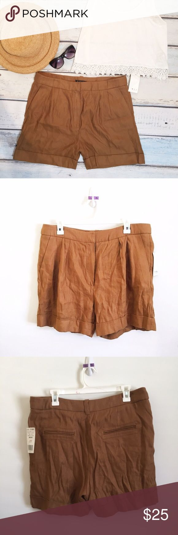 "NWT MNG Mango Paper Bag Linen Shorts New with tags. MNG by Mango brown ""paper bag"" style high waisted shorts. They have a dual hook and eye and button closure and the button is a replacement but you can't tell. Size XL. 50% Linen, 50% viscose. Measures 17.5"" flat at waist, 13.5"" front rise, and 4"" inseam. #nwt #new #mng #mango #brown #shorts #xl #knit #safarishorts #safari #punkydoodle  No modeling Smoke free home  I do discount bundles Mango Shorts"