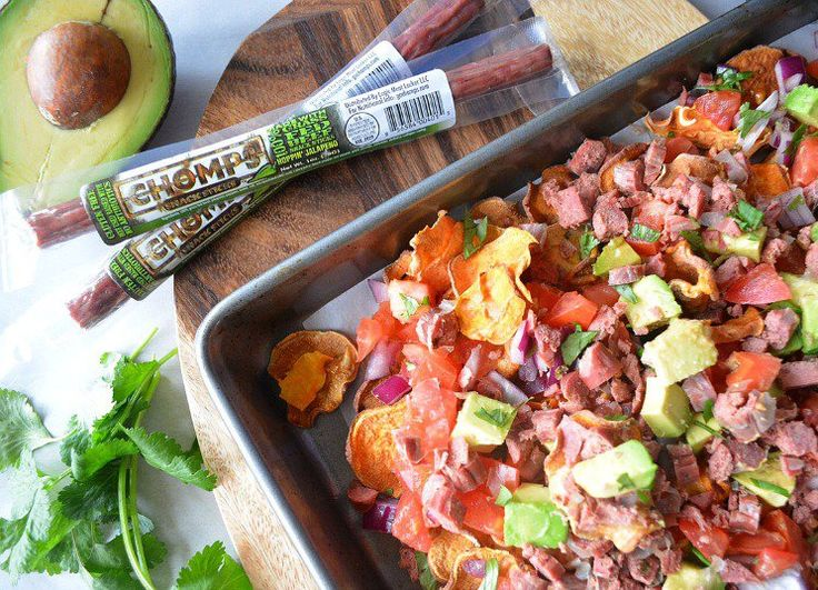 Get blown away with this tasty recipe! Creamy, zesty and super easy: One Pan Paleo Jerky Nachos take traditional nachos to a whole new level.