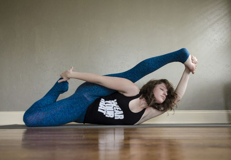 Shoulder and hip stretch with yoga. Ananthasana or Infinity Pose. Tank from WearYourMat #yoga #asana #flexible