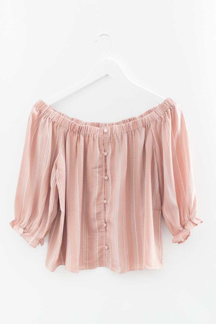 """- Blush pink printed blouse with button up front - Stretch and elasticated off-shoulder neckline - Ruffle sleeve ends - Non-stretch woven material - Size small length measures approx. 18"""" in length -"""