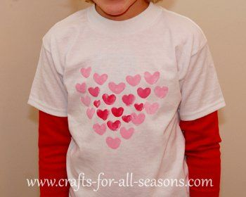 Complete project instruction on how to make adorable Valentine's Day painted shirts using you or your child's fingerprints to create hearts.