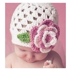 FREE Crochet Baby Hat Patterns Ideal for Beginners  i have made the hat but not the flower really adorable but it is a little different.