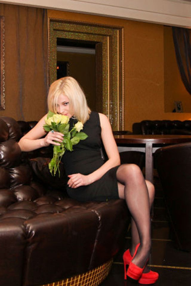 Natalia Poklonskaya (Наталья Поклонская). black dress + red heels + pantyhose + flowers