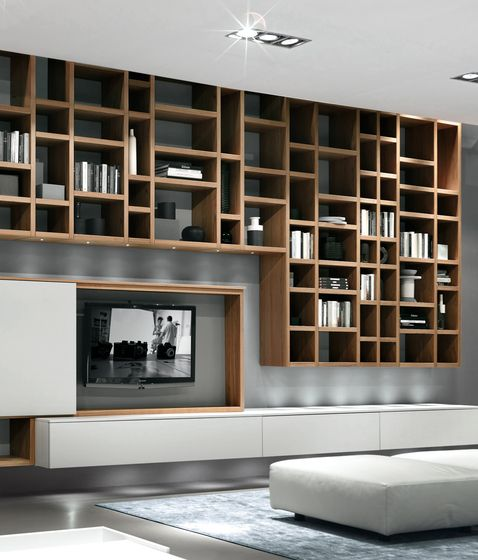 :: FURNITURE :: STUDIOS :: Image Credit: Crossing Misura Emme. inspiration image for interesting shelving solutions. Love wall hung & off the floor library walls. #studios #wallshelving
