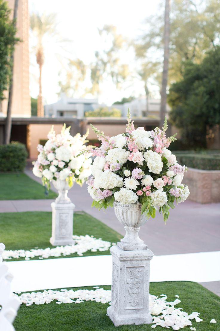 A gorgeous blush Arizona Biltmore Wedding. Pink velvet Mrs. Box!!! Stunning lace cathedral veil. Stunning blush chiffon bridesmaids dresses! And a floral and white silk draped chuppah.
