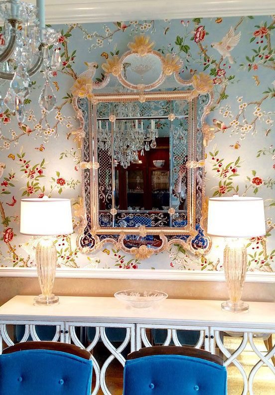 Gorgeous dining room with stunning Venetian glass mirror and Venetian glass  lamps; dining room decor and lighting ideas;