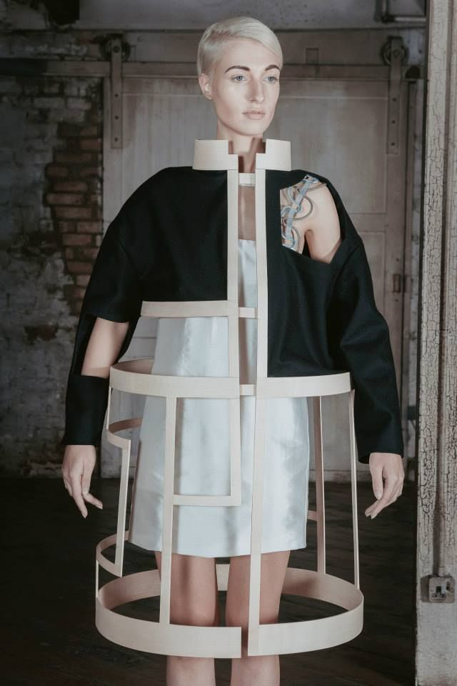 Designer: Charlotte Ham. Clothing Brand: ICE. Conceptual Fashion - sculptural deconstructed jacket exploring negative space; dramatic 3D fashion.