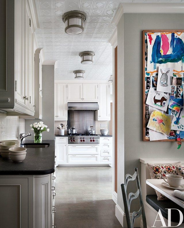 The kitchen's cooktop and hood are by Wolf | archdigest.com