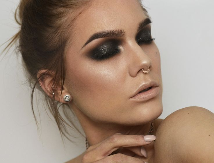 """Smokey Tuesday. I feel like this how my friend sal and my sister think i should turn out. I love the """"badassness"""" here but I don't like the septer piecing. I love the smokey eye tho."""