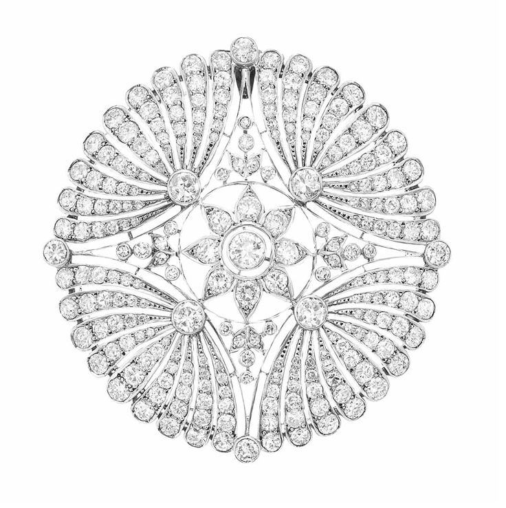 Belle Epoque Platinum and Diamond Pendant-Brooch The pierced openwork circular plaque centering a floret and quartered by stylized fan motifs, set throughout with 237 old European-cut diamonds approximately 14.40 cts., circa 1905, approximately 13.8 dwt.
