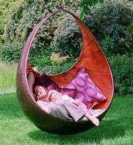 Suspended Pod Loungers - These ultra-chic backyard sculptures are garden swings by Fletcher & Myburgh of Hampshire, England. The magical swings create a wonderland atmo...