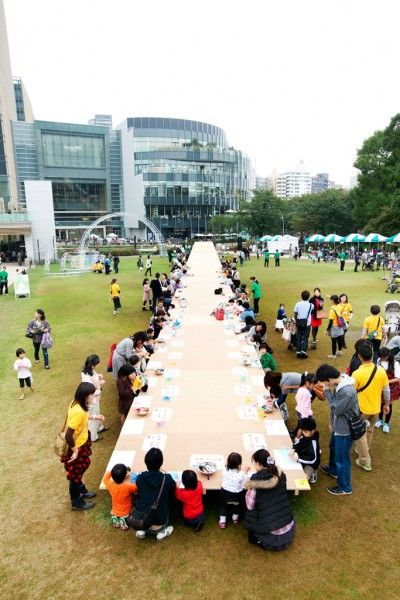 giant sloped picnic table by Torafu Architects