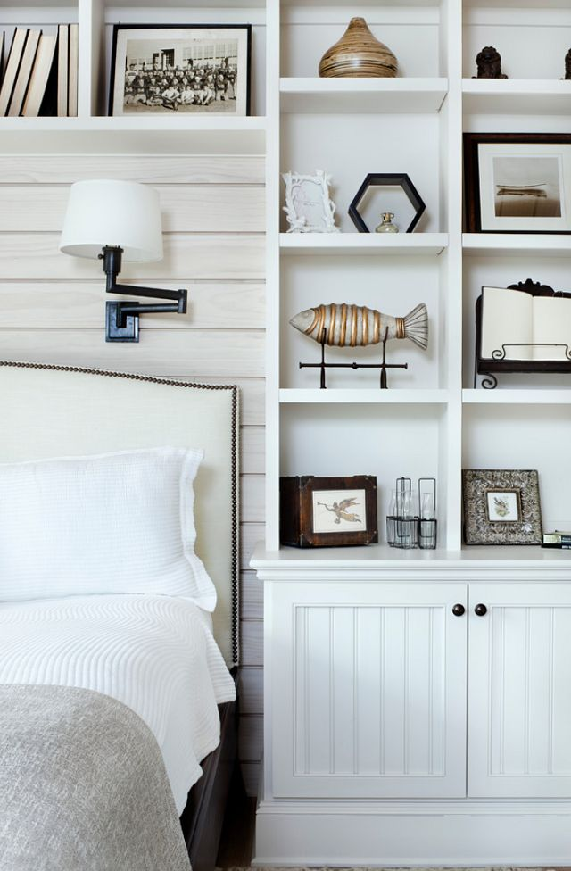 "Love the lamp, ""headboard/backsplash"", and shelves over bed! Stylish built-ins + paneled wall behind bed with upholstered headboard. So cozy."
