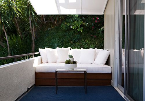 Turn your apartment balcony into a luxurious retreat with a daybed.