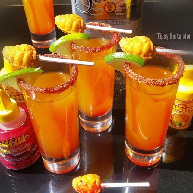 "MANGONEADA SHOTS 1 1/2 oz (45 ml) Silver Tequila 1/2 oz (15 ml) Triple Sec 3 oz (90 ml) Mango Juice/Puree 1 oz (30 ml) Lime Juice 2 Dashes Tapatio Hot Sauce Lucas Gusano Chamoy (Mexican Candy) Mango (del puesto) Chili Powder Lime Mexican Mini Mango Lollipop Pour all ingredients into a shaker with ice Shake & strain into a shots glass Rim with the chili mango powder inside the candy bottles Coat the inside of the glass with ""chamoy"" Lucas Gusano (Mexican Candy) Garnish with Lime and Mexican…"
