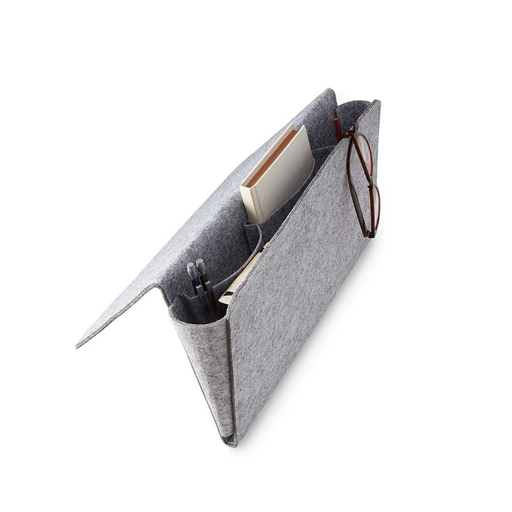 Keep your bedside or couch-cuddling essentials handy with this convenient felt pouch.