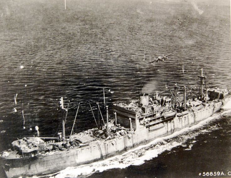 Disaster for Japanese convoy at Ormoc Bay. Despite intense flak, a B-25 of the Far East Air Forces 38th Bomb Group, roars in over Ormoc Bay, Leyte, Philippines, to attack a 8,000 ton Japanese vessel carrying a cargo of trucks and field pieces to reinforce the big Japanese base at Ormoc, Leyte. Note men ducking rather than manning guns. 86,500 pound bombs sank at least three of the convoy's transports and six escorting ships while damaging several others. U.S. Army Signal Corps Photograph…