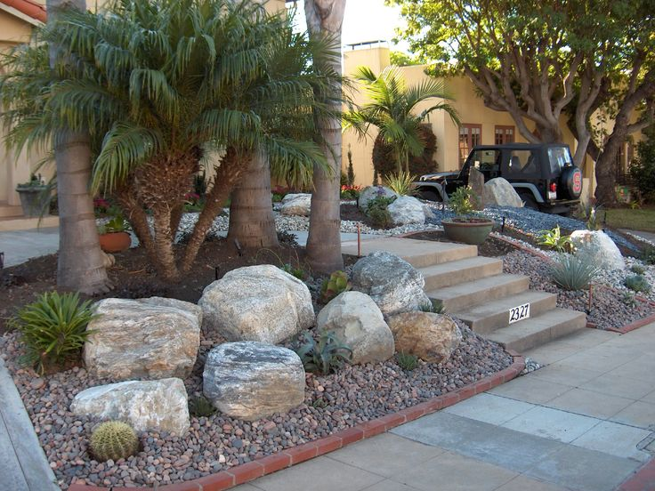 Boulders cobble and gravel with palm trees love this for White gravel landscaping